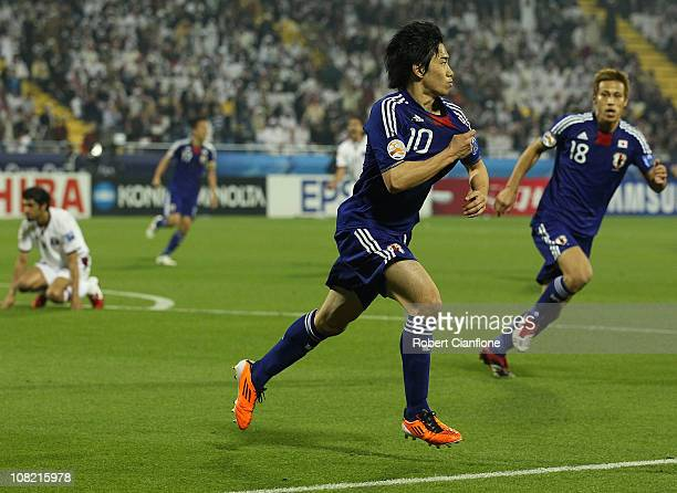 Shinji Kagawa of Japan celebrates his goal during the AFC Asian Cup quarter final match between Japan and Qatar at AlGharafa Stadium on January 21...