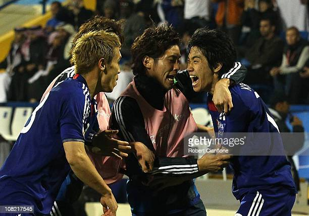Shinji Kagawa of Japan celebrates his goal with teammates during the AFC Asian Cup quarter final match between Japan and Qatar at AlGharafa Stadium...