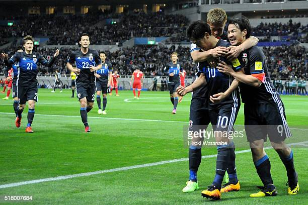 Shinji Kagawa of Japan celebrates scoring a goal with his team mates during the FIFA World Cup Russia Asian Qualifier second round match between...