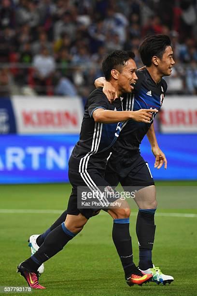 Shinji Kagawa of Japan celebrates scoring his team's first goal with his team mate Yuto Nagatomo during the international friendly match between...