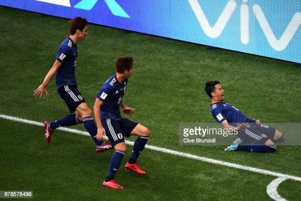Shinji Kagawa of Japan celebrates scoring his team's first goal with Yuya Osako of Japan and Takashi Inui of Japan from the penalty spot during the...