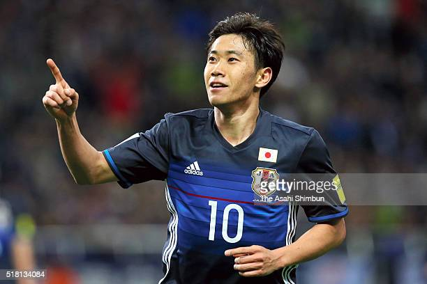 Shinji Kagawa of Japan celebrates scoring his team's fourth goal during the FIFA World Cup Russia Asian Qualifier second round match between Japan...