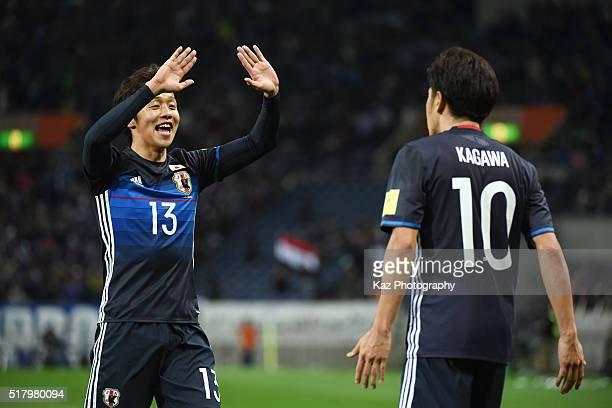 Shinji Kagawa of Japan celebrates scoring his team's fourth goal with his team mate Hiroshi Kiyotake during the FIFA World Cup Russia Asian Qualifier...