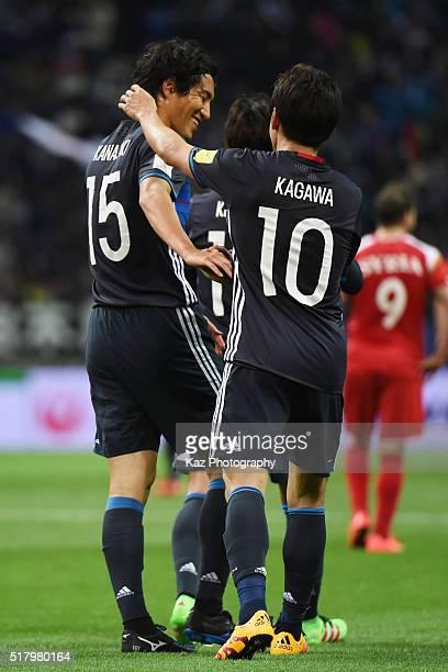 Shinji Kagawa of Japan celebrates scoring his team's fourth goal with his team mate Mu Kanazaki during the FIFA World Cup Russia Asian Qualifier...