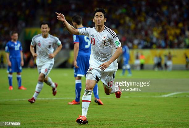 Shinji Kagawa of Japan celebrates scoring his team's second goal during the FIFA Confederations Cup Brazil 2013 Group A match between Italy and Japan...