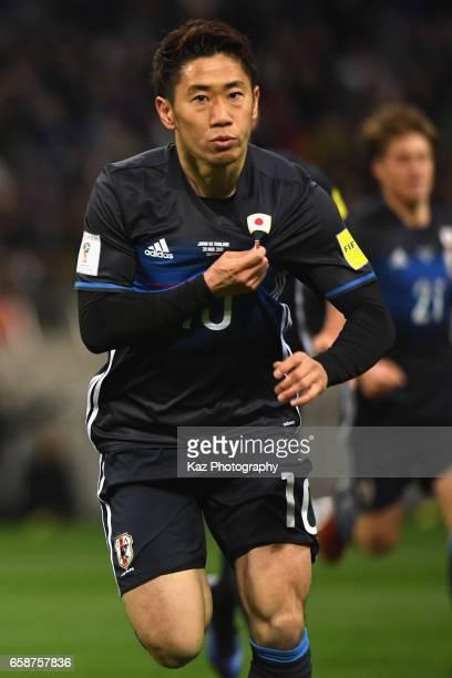 Shinji Kagawa of Japan celebrates scoring the opening goal during the 2018 FIFA World Cup Qualifier match between Japan and Thailand at Saitama...