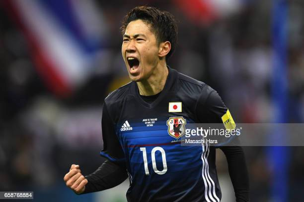 Shinji Kagawa of Japan celebrates scoring the opening goal during the 2018 FIFA World Cup Qualifier match between Japan and Thailand at Saitama...