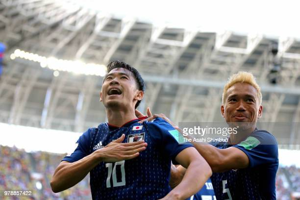 Shinji Kagawa of Japan celebrates scoring the opening goal with his team mate Yuto Nagatomo during the 2018 FIFA World Cup Russia group H match...