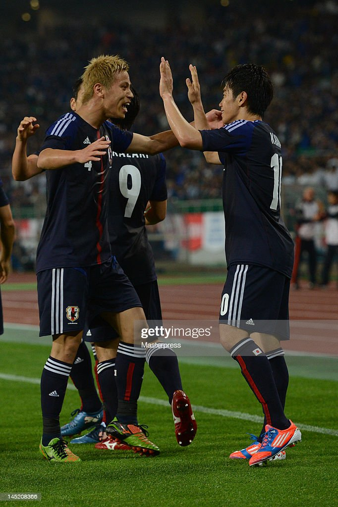 Shinji Kagawa of Japan celebrates the goal with his teammate Keisuke Honda during the international friendly match between Japan and Azerbaijan at Ecopa Stadium on May 23, 2012 in Kakegawa, Japan.
