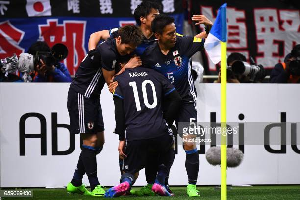 Shinji Kagawa of Japan celebrates with his teammates after scoring the opening goal during the 2018 FIFA World Cup Qualifier match between Japan and...