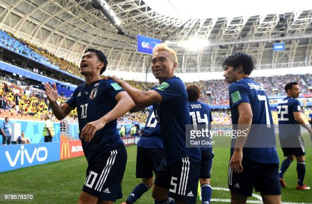 Shinji Kagawa of Japan celebrates with teammates after scoring a penalty for his team's first goal during the 2018 FIFA World Cup Russia group H...