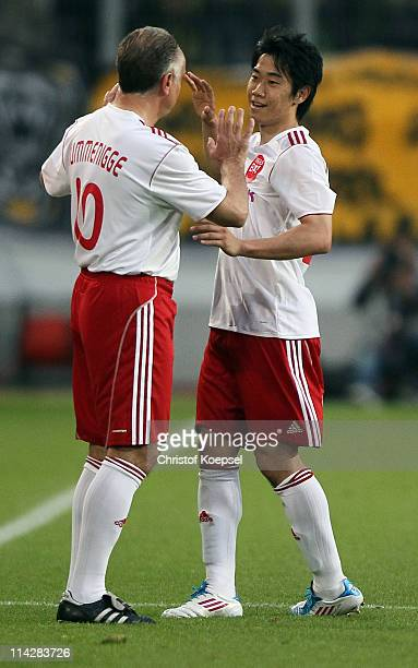 Shinji Kagawa of Japan during his substitution with Michael Rummenigge of Japan during the charity match between Borussia Dortmund and a Team of...
