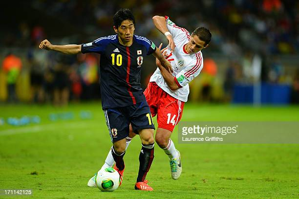 Shinji Kagawa of Japan fights for the ball against Javier Hernandez of Mexico during the FIFA Confederations Cup Brazil 2013 Group A match between...