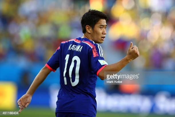 Shinji Kagawa of Japan gestures during the 2014 FIFA World Cup Brazil Group C match between Japan and Colombia at Arena Pantanal on June 24 2014 in...
