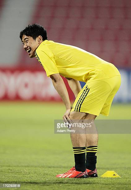 Shinji Kagawa of Japan has a laugh during the training session ahead of the FIFA World Cup Asian qualifier match between Iraq and Japan at AlArabi...