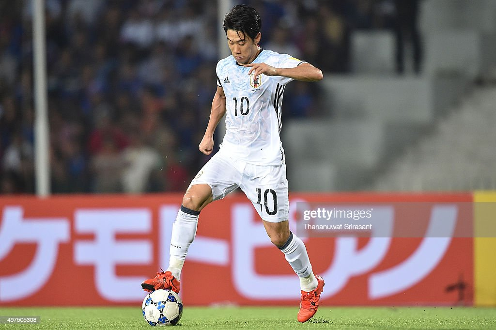 Shinji Kagawa #10 of Japan holds the ball during the 2018 FIFA World Cup Qualifier match between Cambodia and Japan on November 17, 2015 in Phnom Penh, Cambodia.