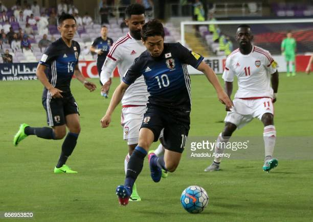 Shinji Kagawa of Japan in action against Abdelaziz Sanqour of United Arab Emirates during the 2018 FIFA World Cup Asian Qualifying group B football...