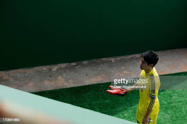 Shinji Kagawa of Japan into the players tunnel after the Japan Training Session at Walmir Campelo Bezerra Stadium on June 16 2013 in Brasilia Brazil