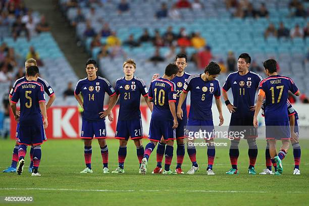 Shinji Kagawa of Japan is comforted by team mates after missing a goal in the penalty shoot out during the 2015 Asian Cup Quarter Final match between...