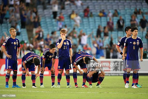 Shinji Kagawa of Japan is consoled by his team mate Maya Yoshida after their penalty shootout defeat in the 2015 Asian Cup Quarter Final match...