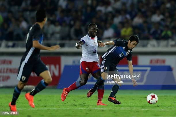 Shinji Kagawa of Japan is tackled by Andrew Anderson JeanBaptiste of Haiti during the international friendly match between Japan and Haiti at Nissan...