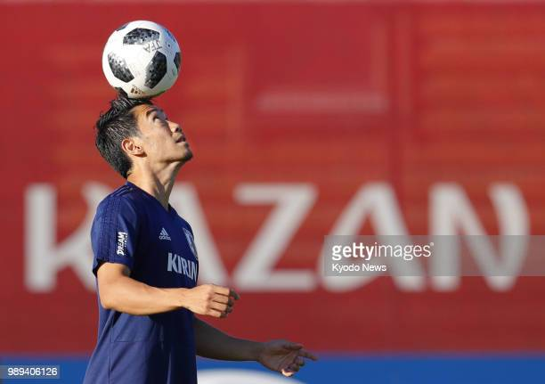 Shinji Kagawa of Japan keeps his eye on the ball during a training session in Kazan Russia on June 29 ahead of a World Cup roundof16 match against...