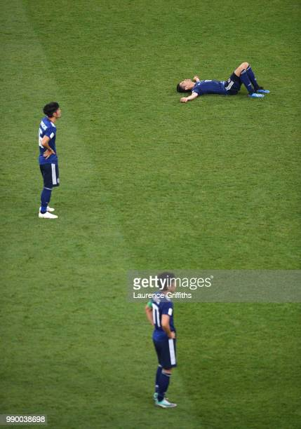 Shinji Kagawa of Japan lies on the pitch dejected followig the 2018 FIFA World Cup Russia Round of 16 match between Belgium and Japan at Rostov Arena...