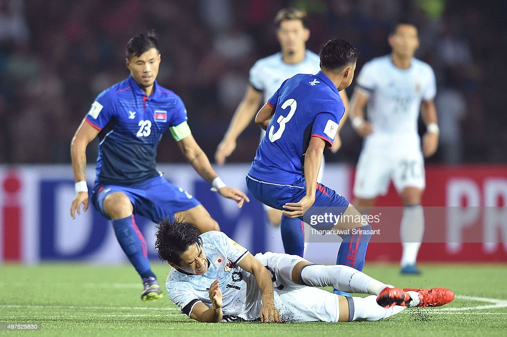 Shinji Kagawa #10 of Japan lies on the pitch during the 2018 FIFA World Cup Qualifier match between Cambodia and Japan on November 17, 2015 in Phnom Penh, Cambodia.