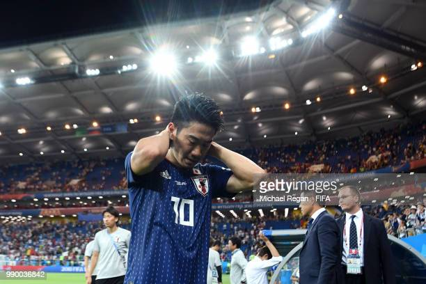 Shinji Kagawa of Japan looks dejected following his sides defeat in the 2018 FIFA World Cup Russia Round of 16 match between Belgium and Japan at...