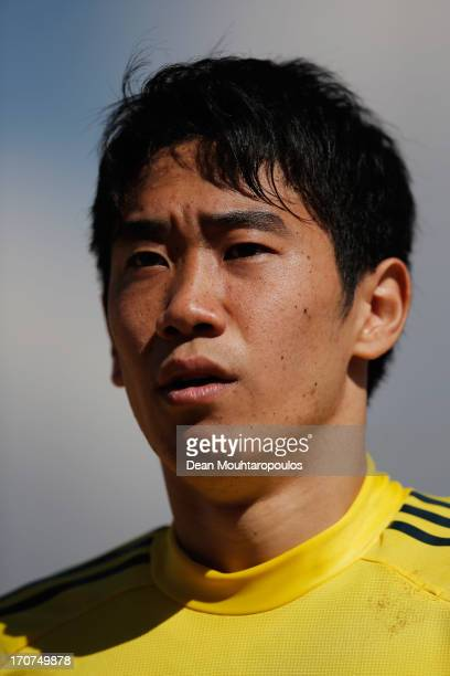 Shinji Kagawa of Japan looks on during the Japan Training Session at Centro de Capacitacao Fisica dos Bombeiros or Training Centre for Firebrigade...