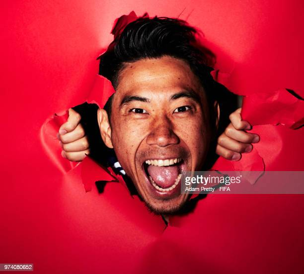 Shinji Kagawa of Japan poses for a portrait during the official FIFA World Cup 2018 portrait session at the FC Rubin Training Grounds on June 14 2018...