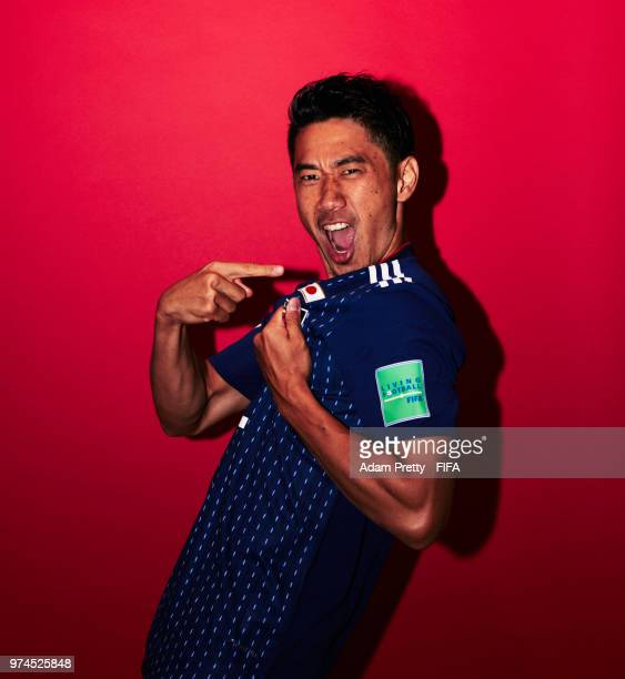 Shinji Kagawa of Japan poses for a portrait during the official FIFA World Cup 2018 portrait session at the FC Rubin Training Grounds on June 14,...