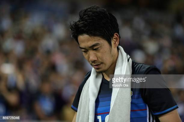 Shinji Kagawa of Japan reacts after his side's 33 draw in the international friendly match between Japan and Haiti at Nissan Stadium on October 10...