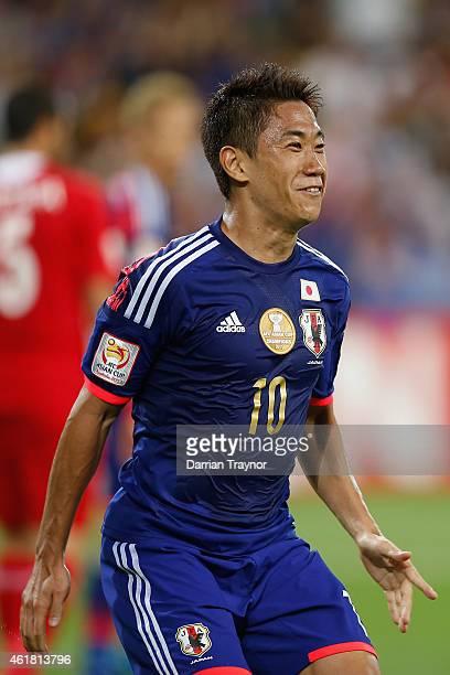 Shinji Kagawa of Japan reacts after scoring a goal during the 2015 Asian Cup match between Japan and Jordan at AAMI Park on January 20 2015 in...