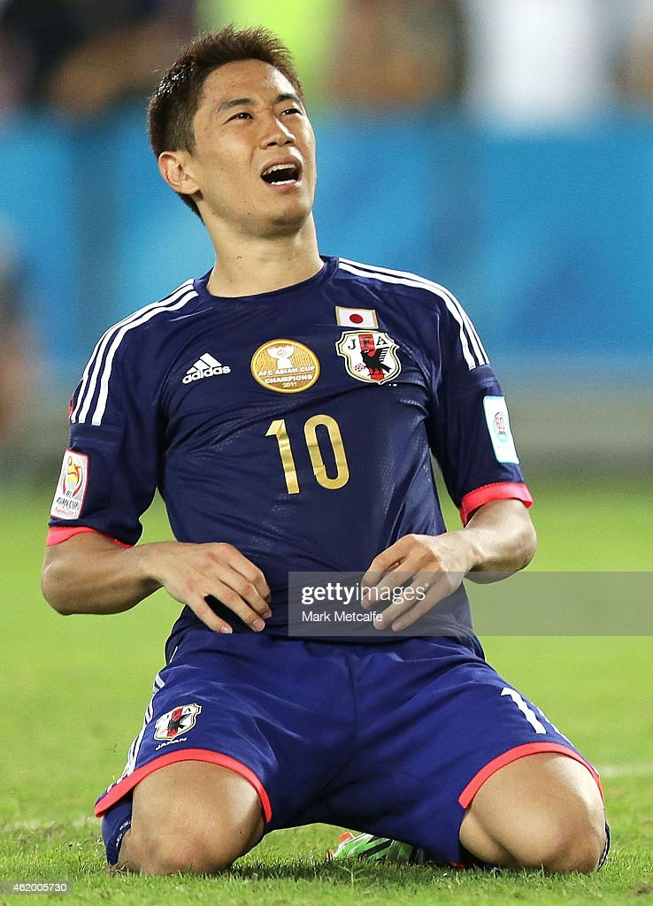 Shinji Kagawa of Japan reacts to missing a penalty during the 2015 Asian Cup Quarter Final match between Japan and the United Arab Emirates at ANZ Stadium on January 23, 2015 in Sydney, Australia.