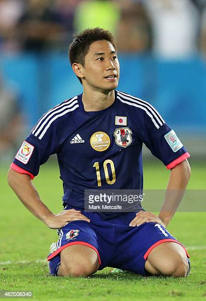 Shinji Kagawa of Japan reacts to missing a penalty during the 2015 Asian Cup Quarter Final match between Japan and the United Arab Emirates at ANZ...