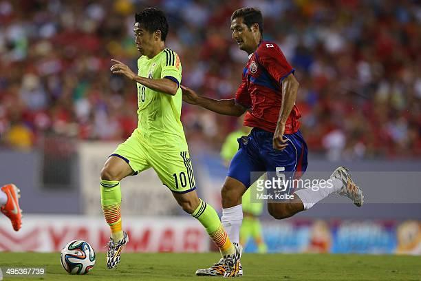 Shinji Kagawa of Japan runs the ball toward goal during the International Friendly Match between Japan and Costa Rica at Raymond James Stadium on...