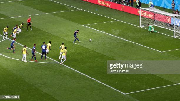 Shinji Kagawa of Japan scores a penalty for his team's first goal past David Ospina of Colombia during the 2018 FIFA World Cup Russia group H match...
