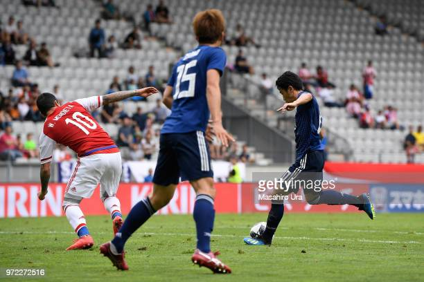 Shinji Kagawa of Japan scores his side's fourth goal during the international friendly match between Japan and Paraguay at Tivoli Stadion on June 12...