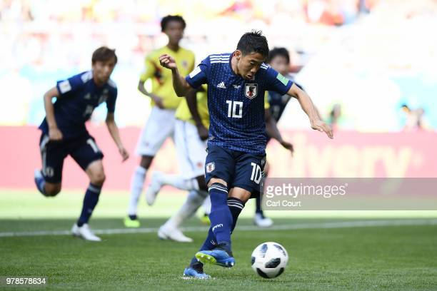 Shinji Kagawa of Japan scores his team's first goal from the penalty spot during the 2018 FIFA World Cup Russia group H match between Colombia and...