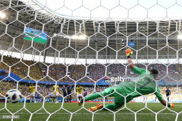 Shinji Kagawa of Japan scores his team's first goal past David Ospina of Colombia during the 2018 FIFA World Cup Russia group H match between...