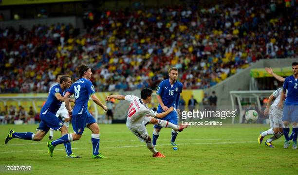 Shinji Kagawa of Japan scores his team's second goal during the FIFA Confederations Cup Brazil 2013 Group A match between Italy and Japan at Arena...