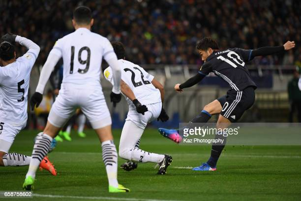 Shinji Kagawa of Japan scores the opening goal during the 2018 FIFA World Cup Qualifier match between Japan and Thailand at Saitama Stadium on March...
