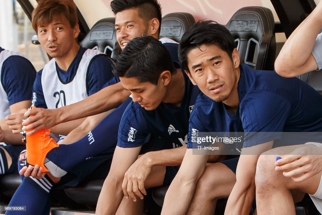Shinji Kagawa of Japan sits on the bench prior to the international friendly match between Switzerland and Japan at the Stadium Cornaredo on June 8, 2018 in Lugano, Switzerland.