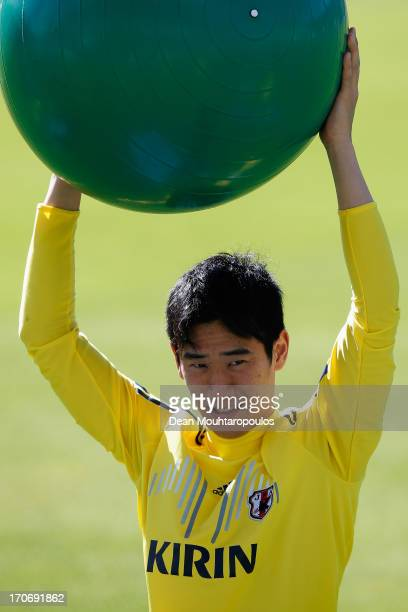 Shinji Kagawa of Japan stretches with a Swiss Ball during the Japan Training Session at Walmir Campelo Bezerra Stadium on June 16 2013 in Brasilia...