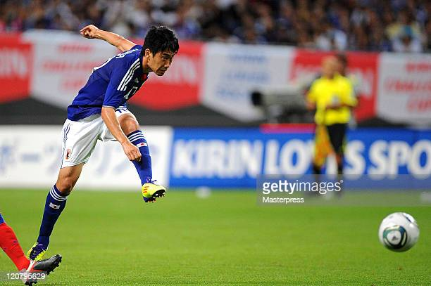 Shinji Kagawa of Japan takes a shot at goal during the international friendly match between Japan and South Korea at Sapporo Dome on August 10 2011...