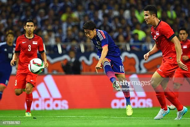 Shinji Kagawa of Japan takes a shot during the 2018 FIFA World Cup Asian Qualifier second round match between Japan and Singapore at Saitama Stadium...