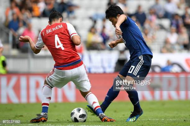 Shinji Kagawa of Japan takes on Fabian Balbuena of Paraguay during the international friendly match between Japan and Paraguay at Tivoli Stadion on...