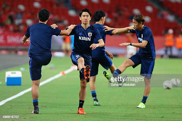 Shinji Kagawa of Japan warms up with teammates during the 2018 FIFA World Cup Qualifier match between Singapore and Japan at National Stadium on...