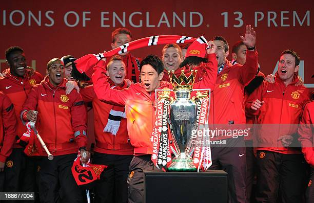 Shinji Kagawa of Manchester United celebrates during the Manchester United Premier League Winners Parade at Manchester Town Hall on May 13 2013 in...